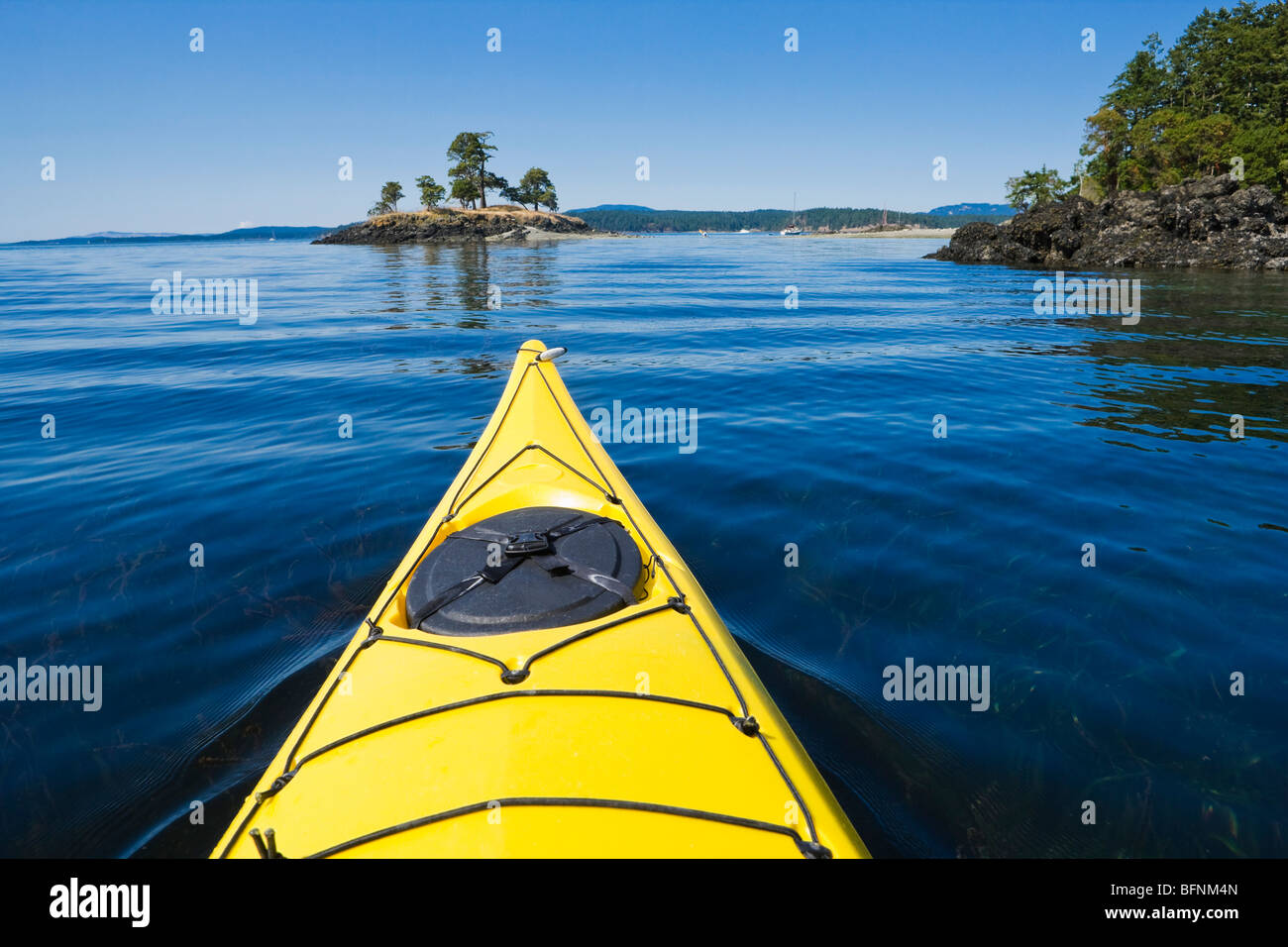 The bow of a sea kayak on the water near Turn Island in the San Juan Islands of Washington State, USA. - Stock Image