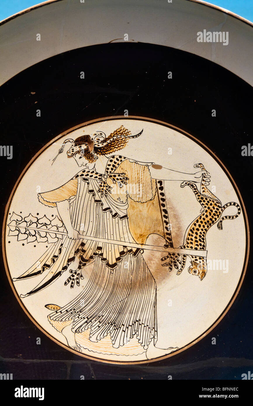 A maenad carrying a panther and a thyrsos. See description for more information. Stock Photo