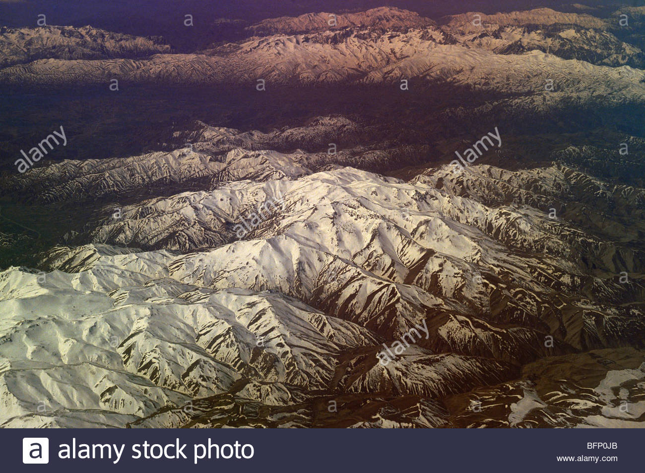 SBA 64334 : Snow capped mountain peaks aerial overflying Iran - Stock Image