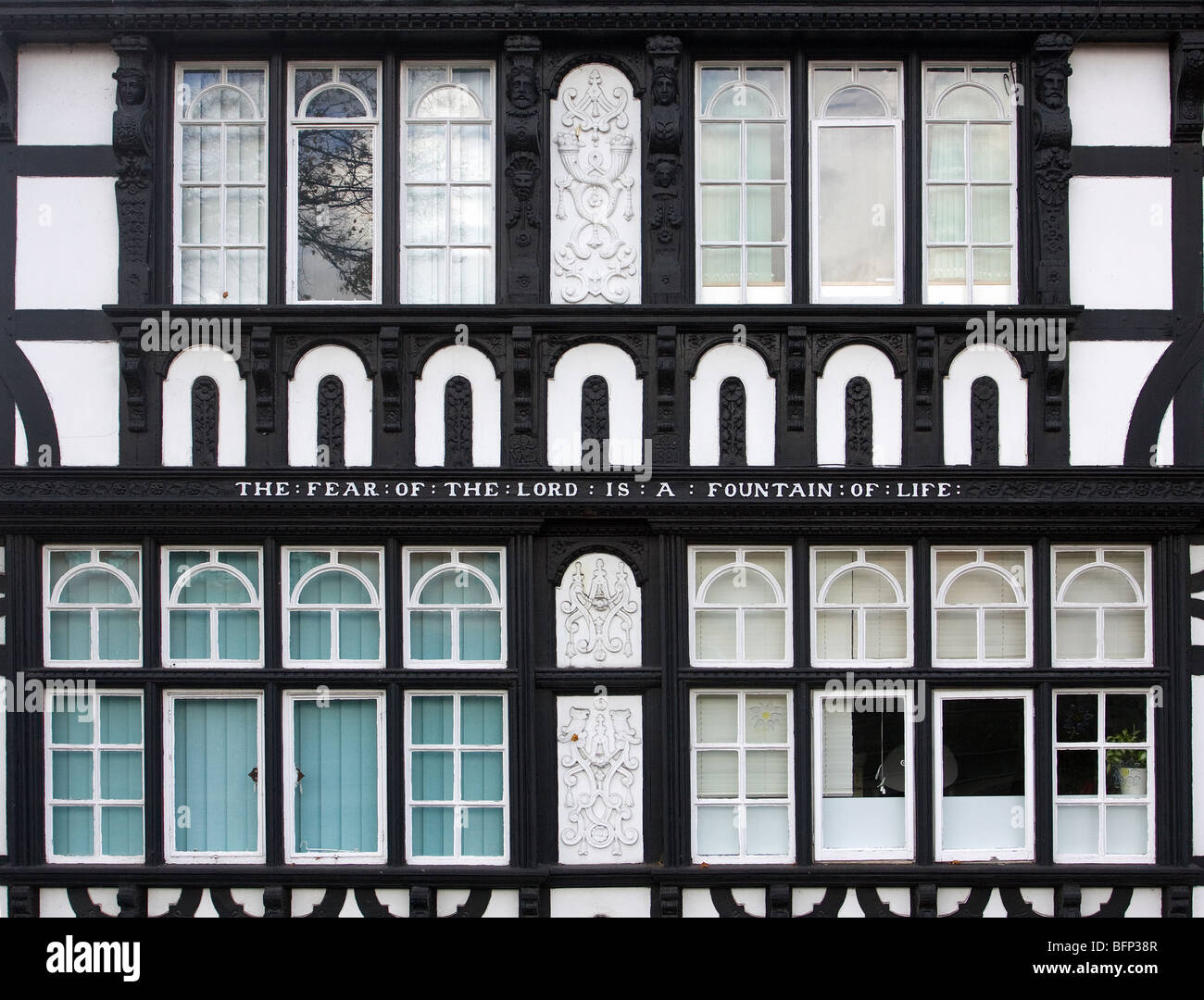 Facade of house dated 1881 in Chester with Biblical quotation from Proverbs 14:27 The Fear of the Lord Is A Fountain - Stock Image
