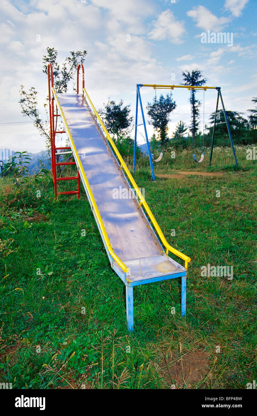 Children playground slide swings in Cedar Heights Resort at Koti Himachal Pradesh India - Stock Image