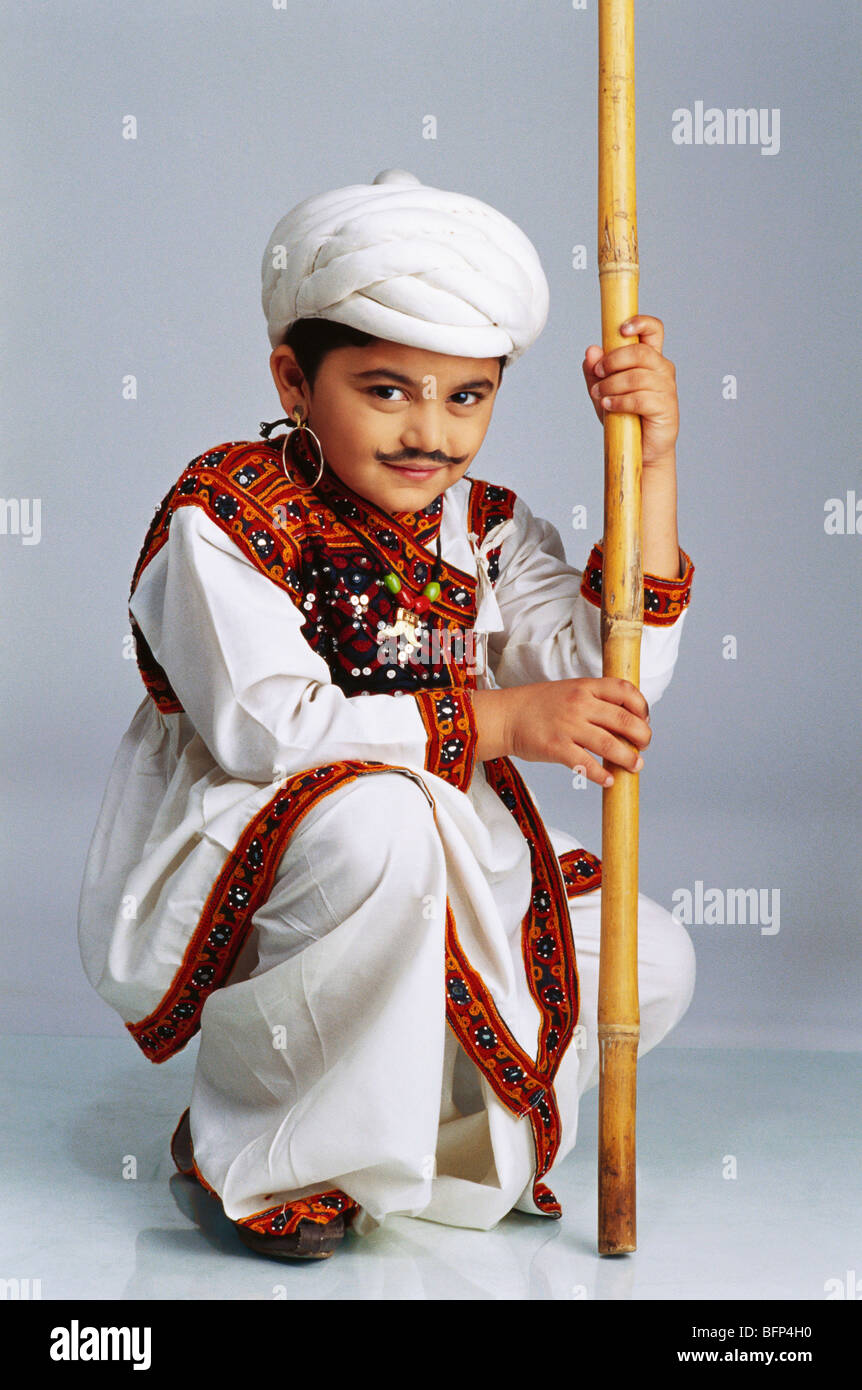 13cffe677 VDA 63629 : Boy dressed as Gujarati holding stick MR#498 - Stock Image