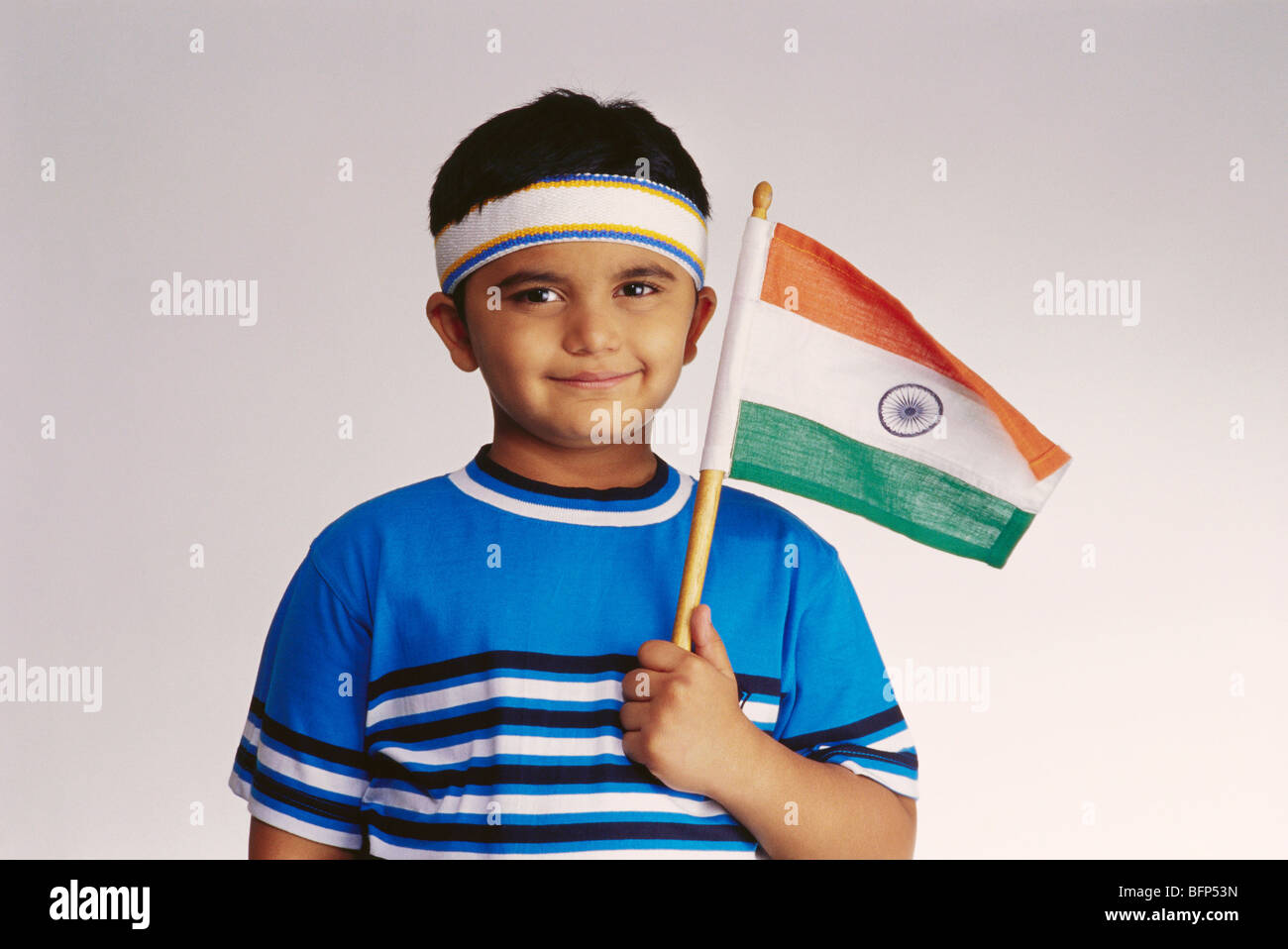 f5e08fd1a VDA 63751 : Boy dressed as hockey player holding flag of India in hand MR#