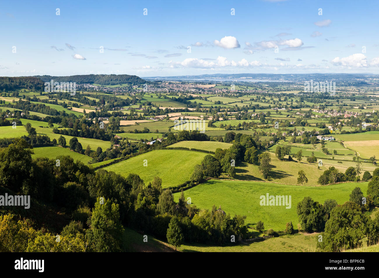 A view of Cam, Dursley and Coaley in the Severn Vale viewed from the Cotswold scarp at Coaley Peak Picnic Site, - Stock Image