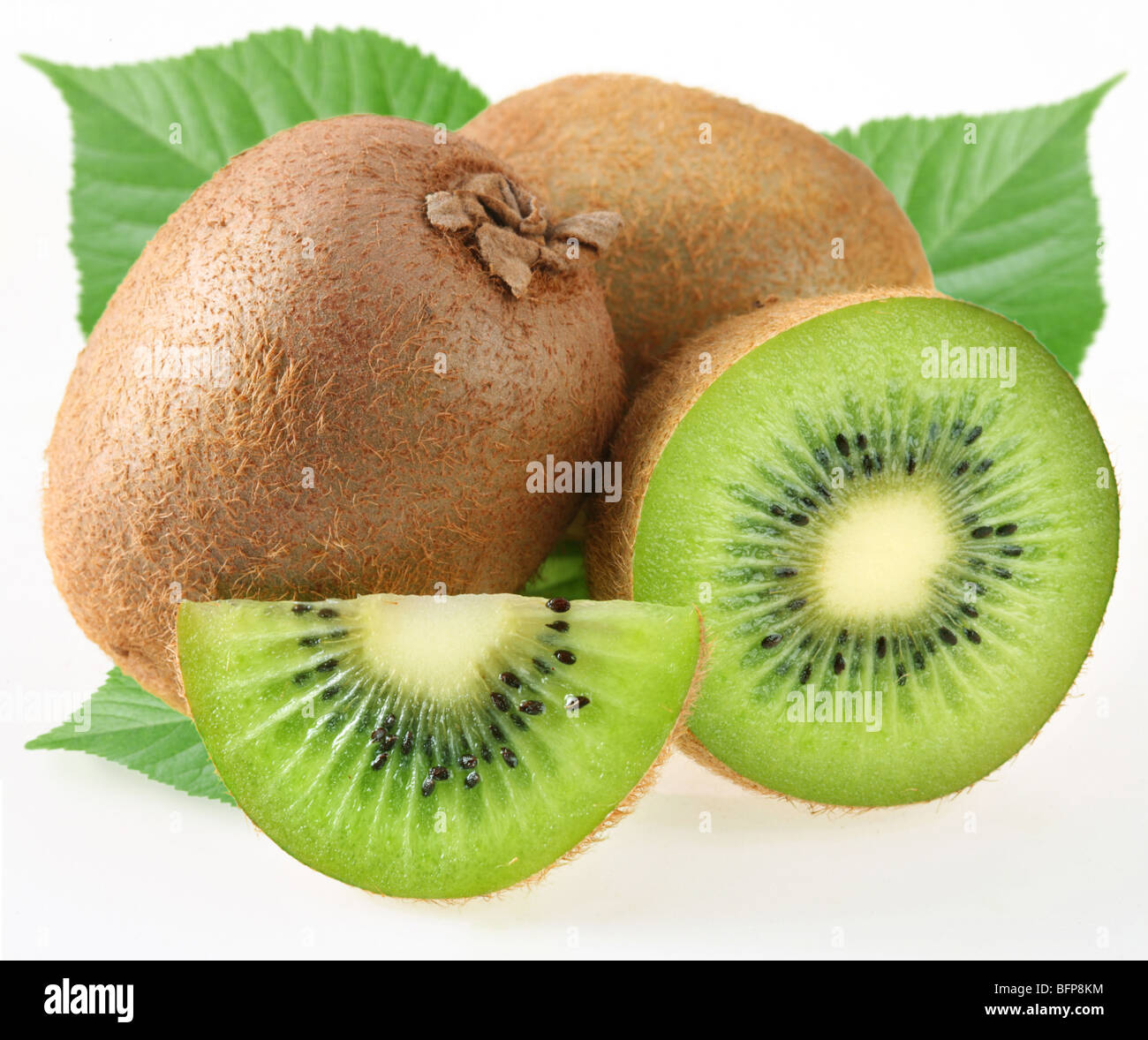 Kiwi with leaves on a white background - Stock Image