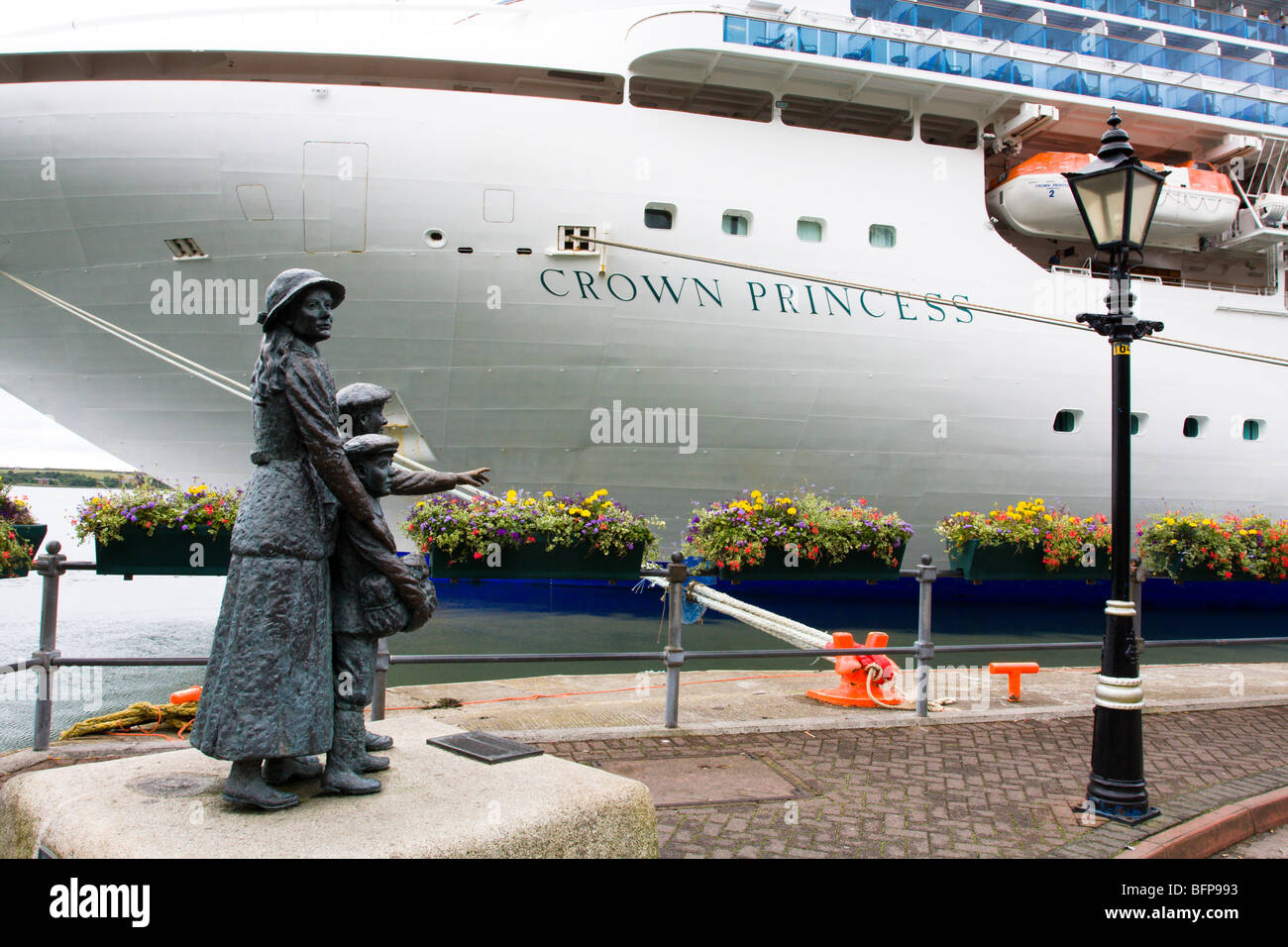 Crown Princess liner docked at Cobh, Cork, Ireland with statue of Annie Moore in foreground - Stock Image