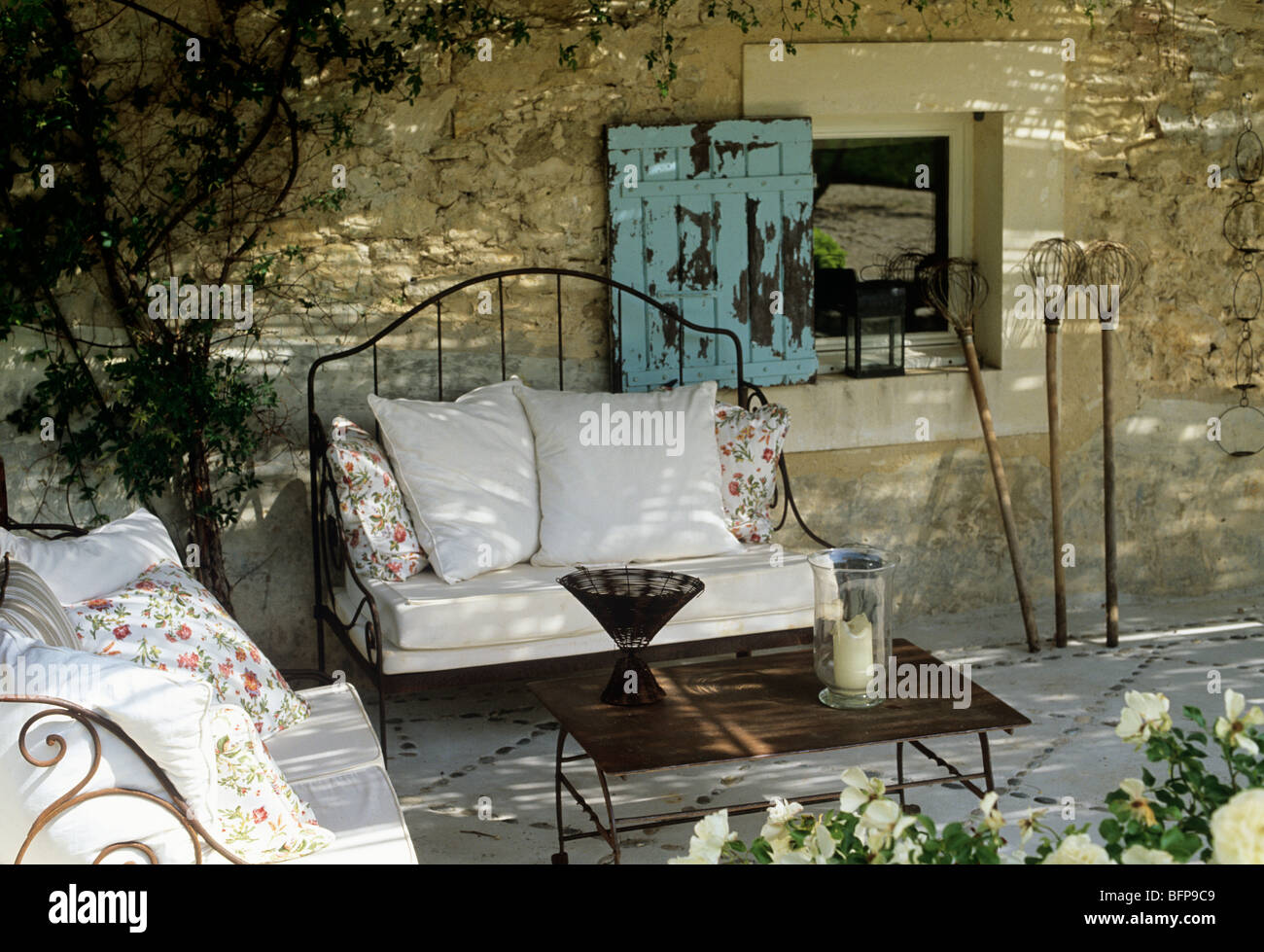 Courtyard of a Luberon farmhouse renovation with locally sourced rustic pieces. Stock Photo