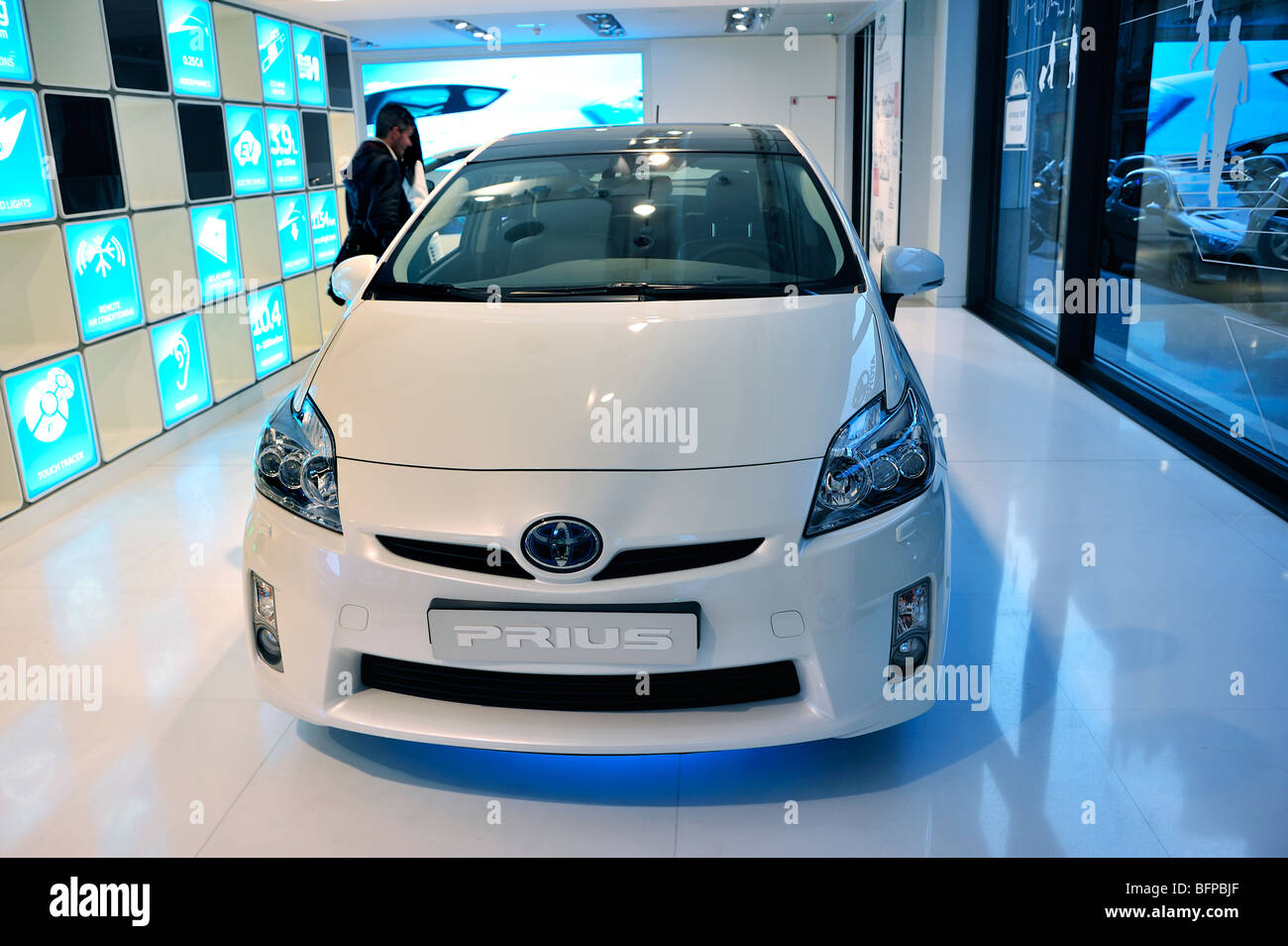 Paris, France, Couple Shopping in New Car Showroom, Toyota Prius Car, gas-electric Hybid Motor - Stock Image