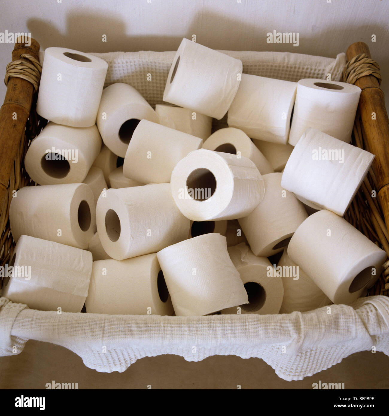 Basket of loo roll/ toilet roll - Stock Image