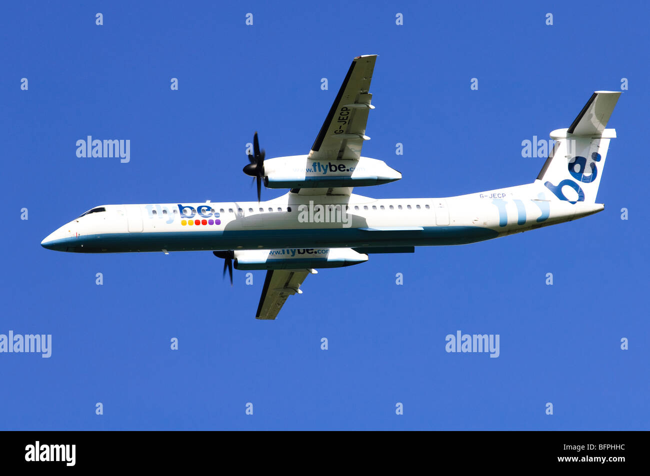 Bombardier Dash 8 operated by Flybe banking after take off from Birmgham Airport, UK. - Stock Image