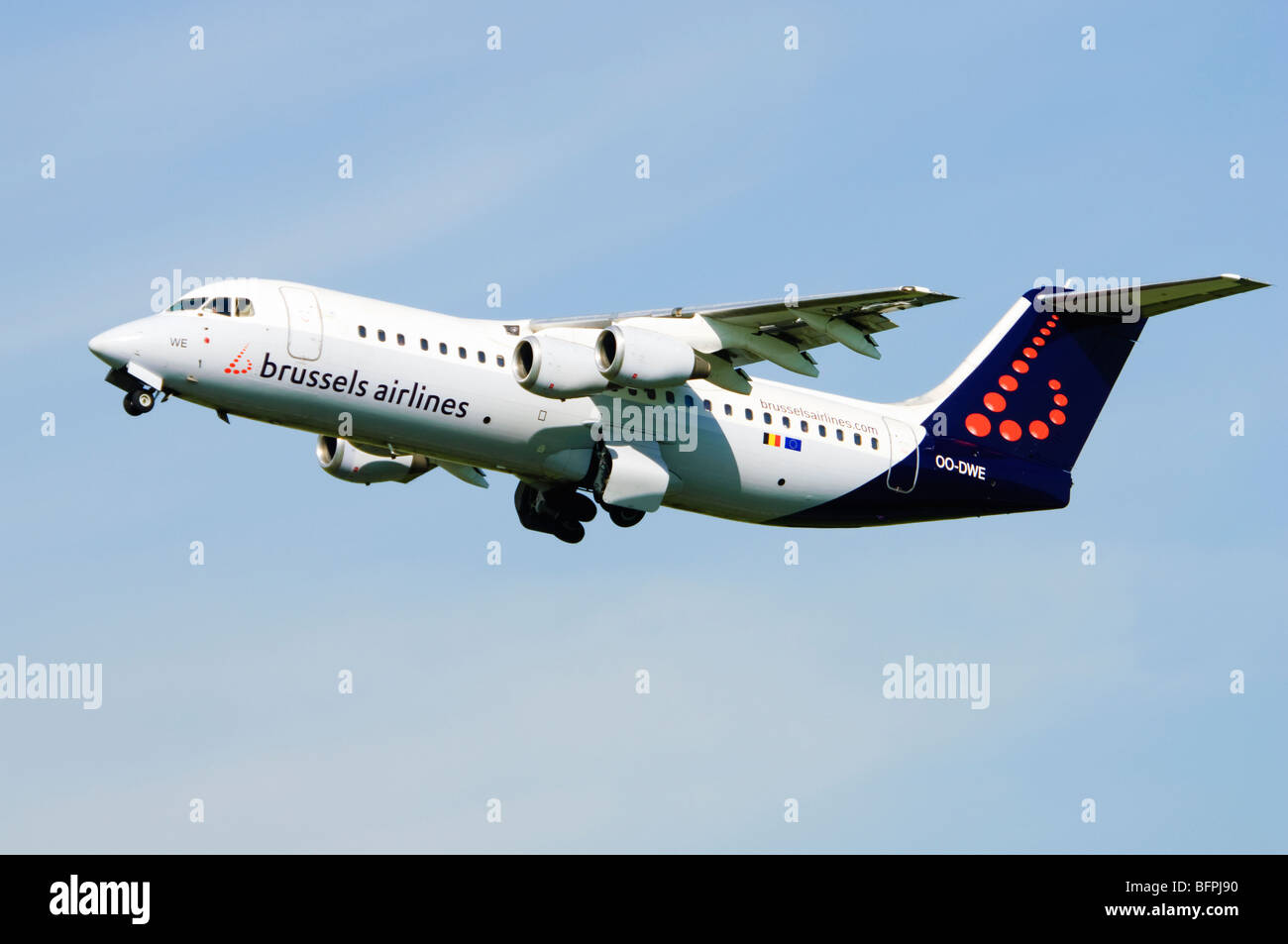 Avro RJ100 operated by Brussels Airlines climbing out from taking off at Birmingham Airport, UK. - Stock Image