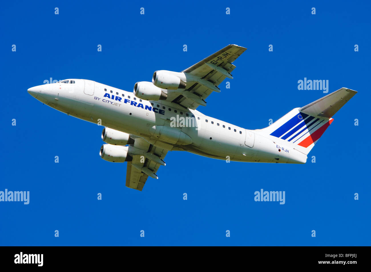 Avro RJ85 operated by Cityjet on behalf of Air France climbing out after taking off from Birmingham Airport, UK. - Stock Image