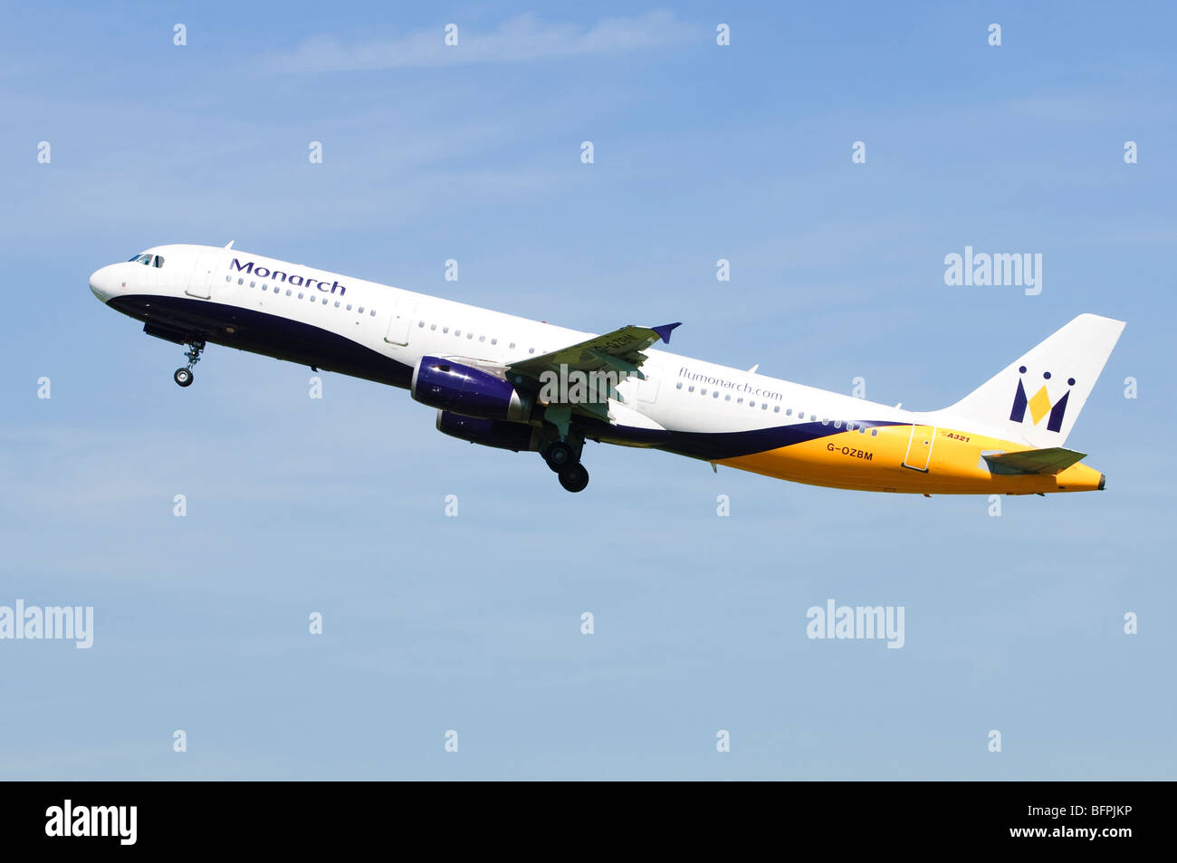 Airbus A321 operated by Monarch Airlines climbing out after take off from Birmingham Airport, UK. Stock Photo