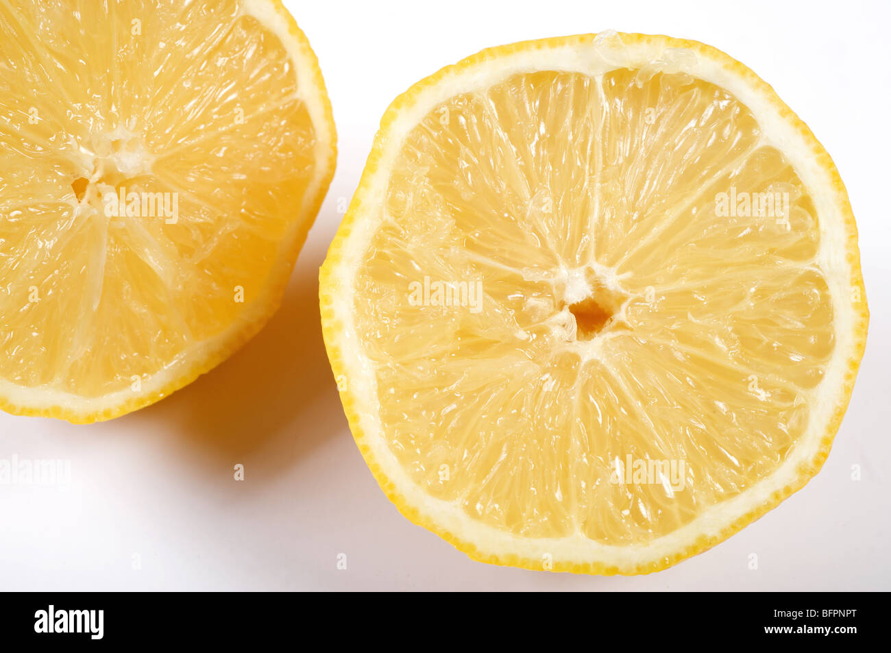 Fresh Lemon cut in two - Stock Image