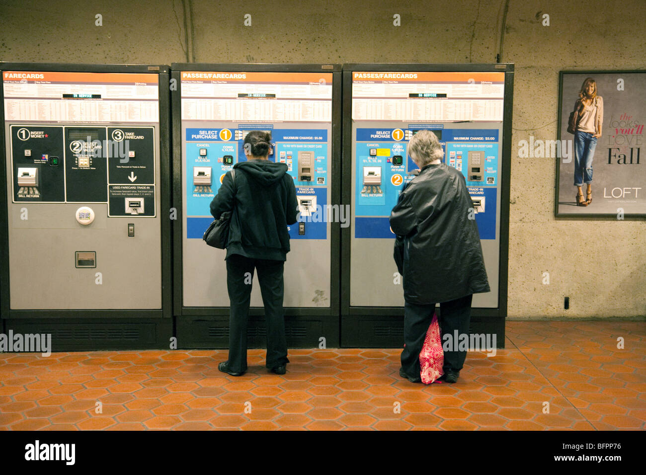 Passengers buying tickets from machines, the metrorail or metro underground rail system, Washington DC USA - Stock Image