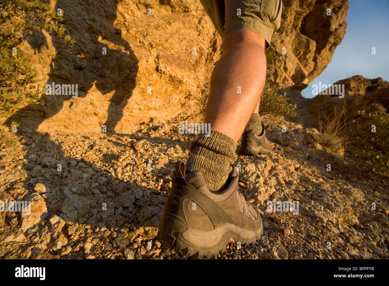 A man working up steep terraine in the southwest - Stock Image