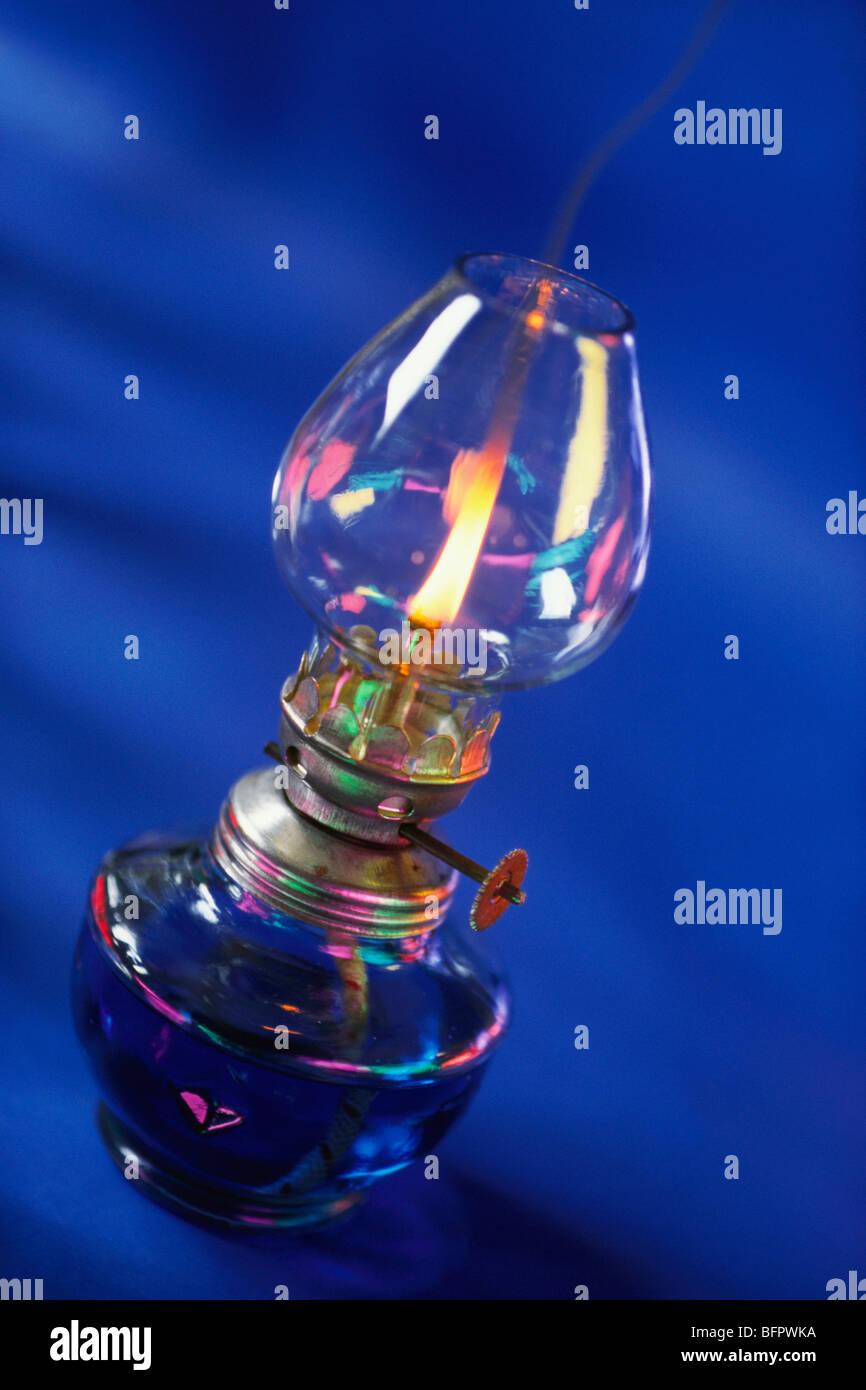 VHM 66480 : Concept ; kerosene oil lamp on blue background - Stock Image