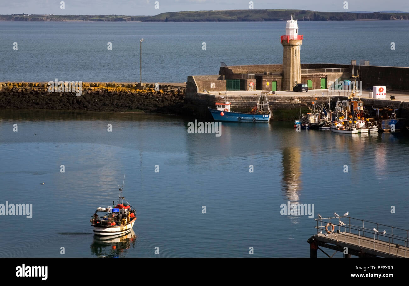 Fishing Harbour and Lighthouse designed by Alexander Nimmo in 1814, Dunmore East, County Waterford, Ireland - Stock Image