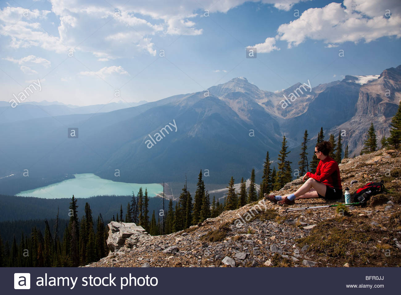A woman admires a hard earned view. - Stock Image