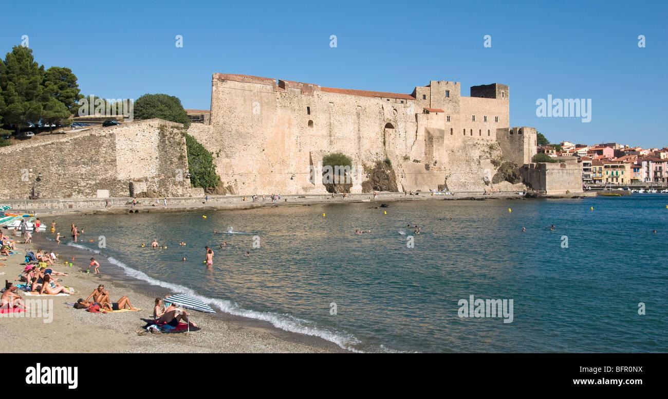 Collioure Chateau Royale and harbour Plage de port d Avall - Stock Image
