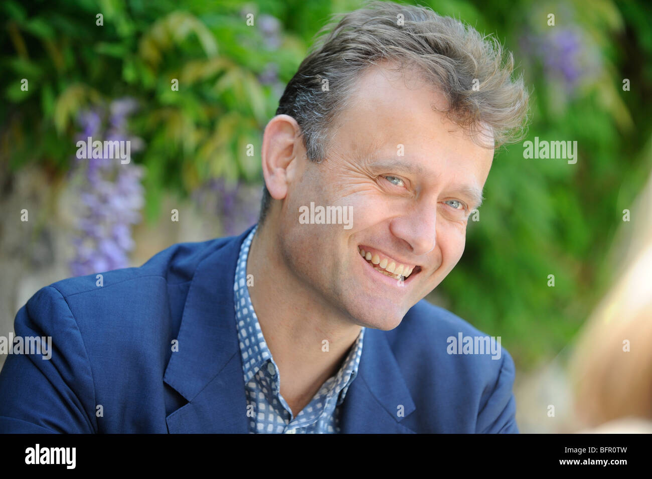 Portrait of  'The Now Show' comedian and actor Hugh Dennis. - Stock Image