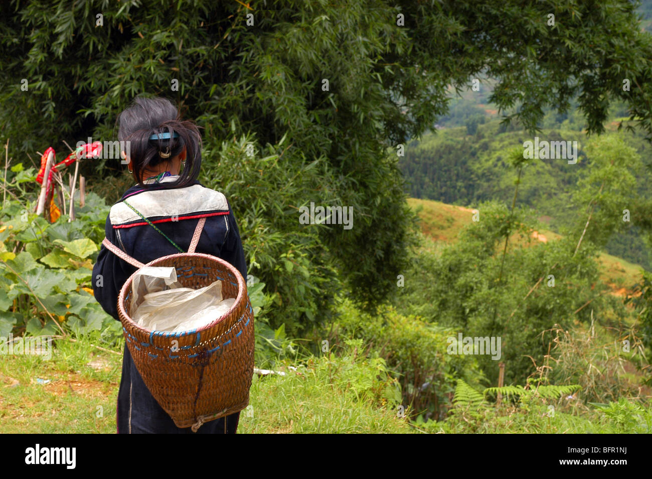 Lao Cai Province, North Vietnam Sapa Local girl in tribal dress Elizabeth Bailie - Stock Image