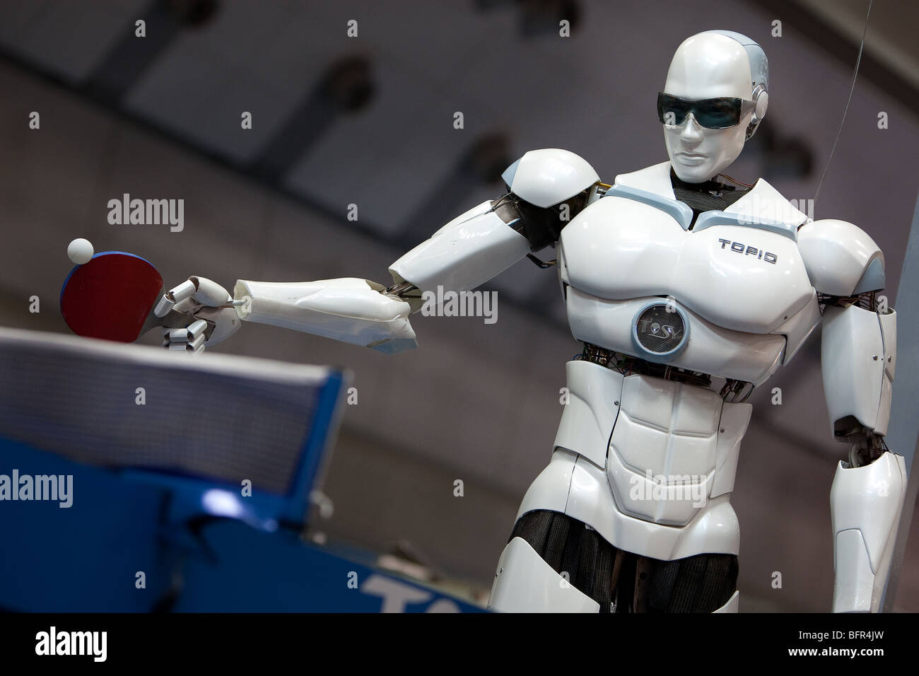 'TOPIO' a ping pong playing robot, produced by Vietnamese company Tosy, on display at the International Robot Exhibition, Stock Photo