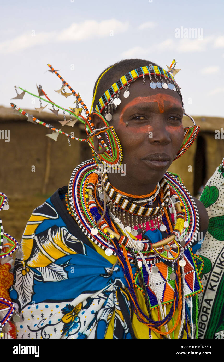 Maasai woman wearing brightly coloured beadwork and an intricate headdress - Stock Image