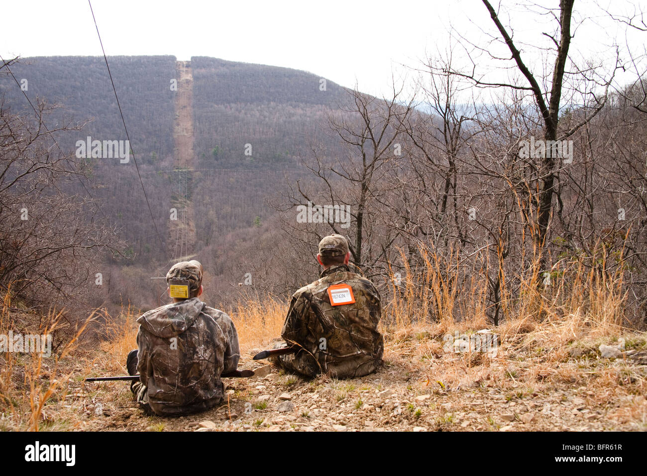 A father and son on a spring turkey hunt - Stock Image