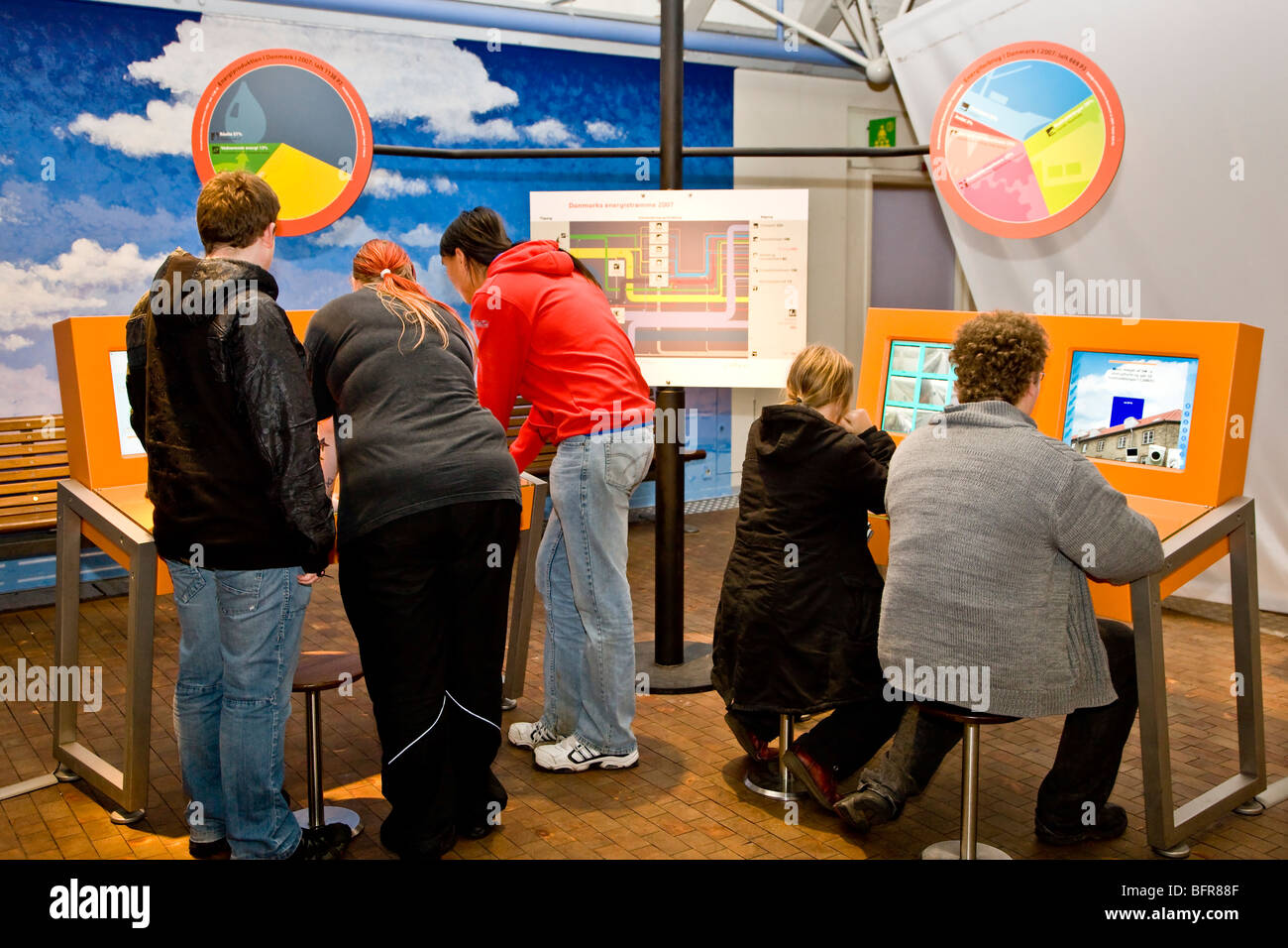 Young people learning about the consumption of energy in Denmark - Stock Image