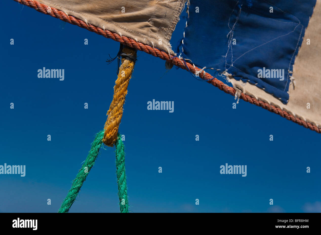 Colourful rope attached to sail - Stock Image