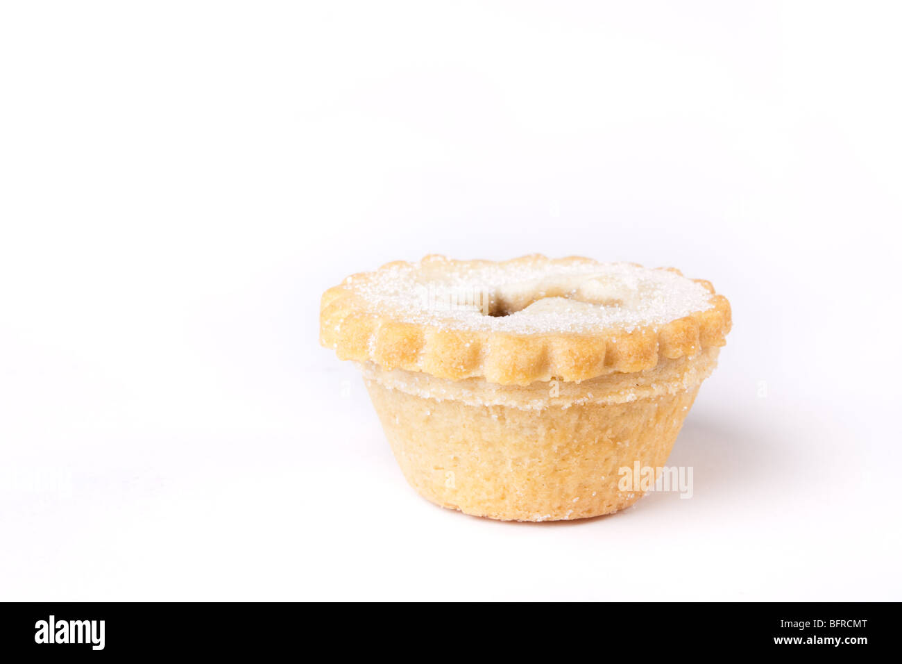 Single Sweet Mince Pie isolated against white background. - Stock Image