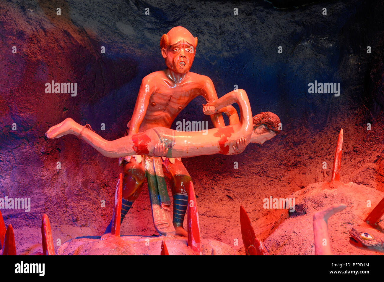 Chinese Torture in Hell Fire, Satan or the Devil Impaling Sinner on Stakes, Fifth Court of Hell, Tiger Balm Gardens, - Stock Image