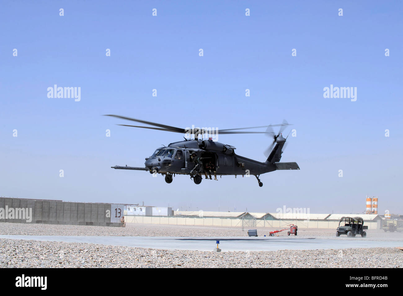 An HH-60G Pave Hawk taking off from Camp Bastion, Afghanistan. - Stock Image