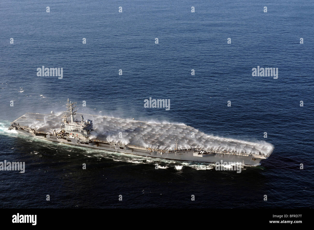 Countermeasure wash down sprinklers activated on the aircraft carrier USS Ronald Reagan. - Stock Image