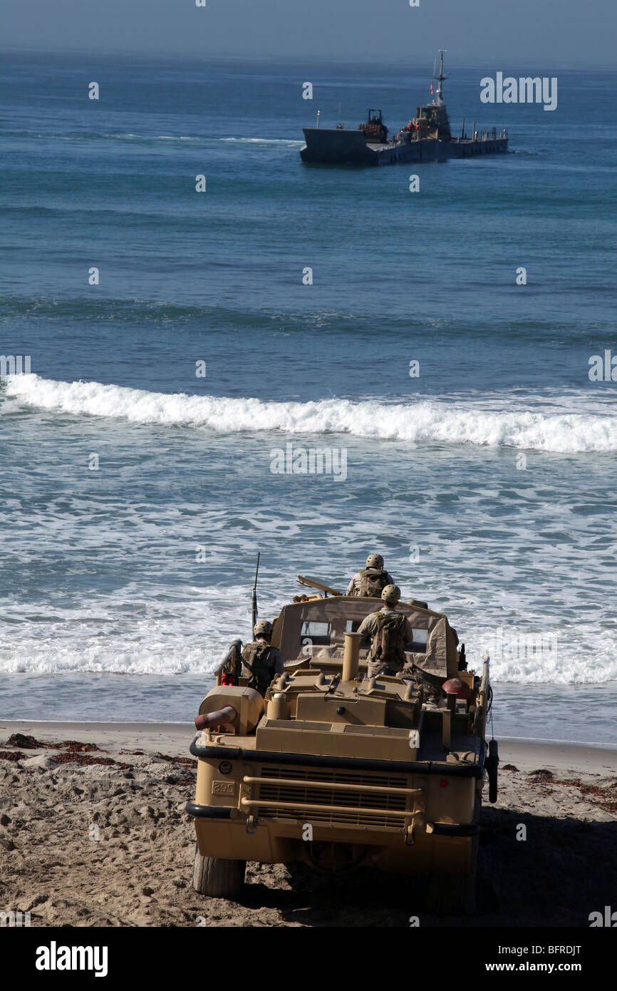 Marines anticipate the arrival of an Improved Navy Lighterage System. - Stock Image