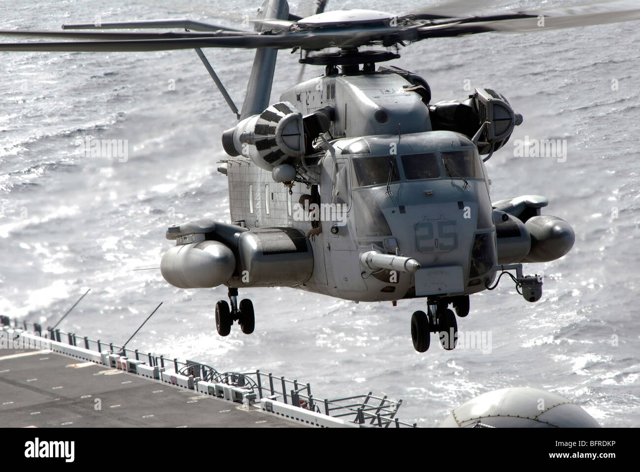 A CH-53E Super Stallion helicopter takes off from USS Makin Island. - Stock Image