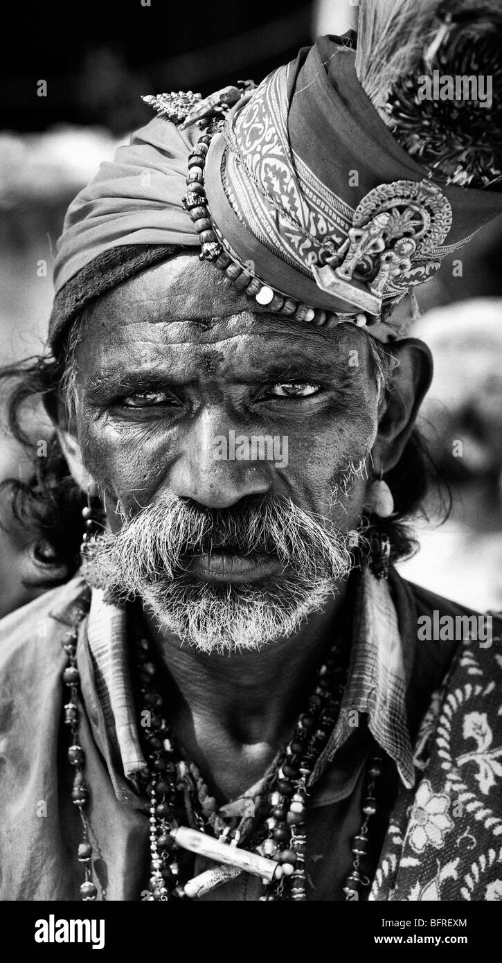 Religious Indian beggar man. Andhra Pradesh, India. Black and White - Stock Image