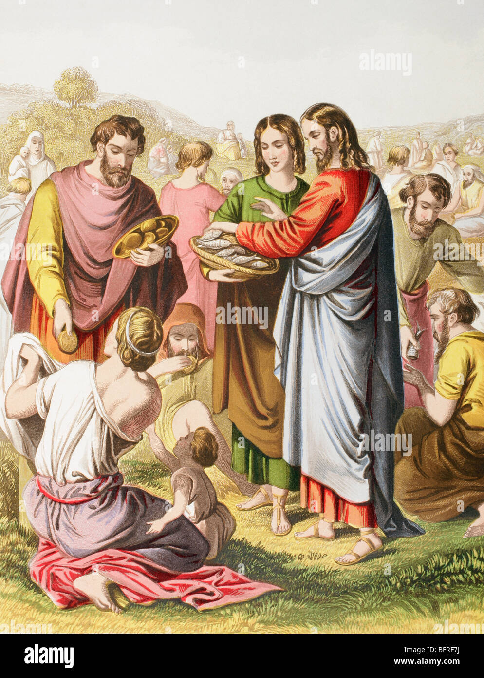 Jesus feeding the multitude.  The miracle of loaves and fishes. - Stock Image