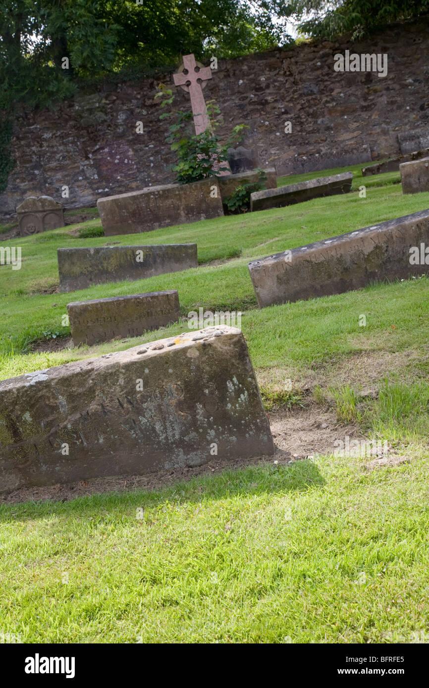Sunken gravestones at Clackmannan Parish Church, Scotland - Stock Image