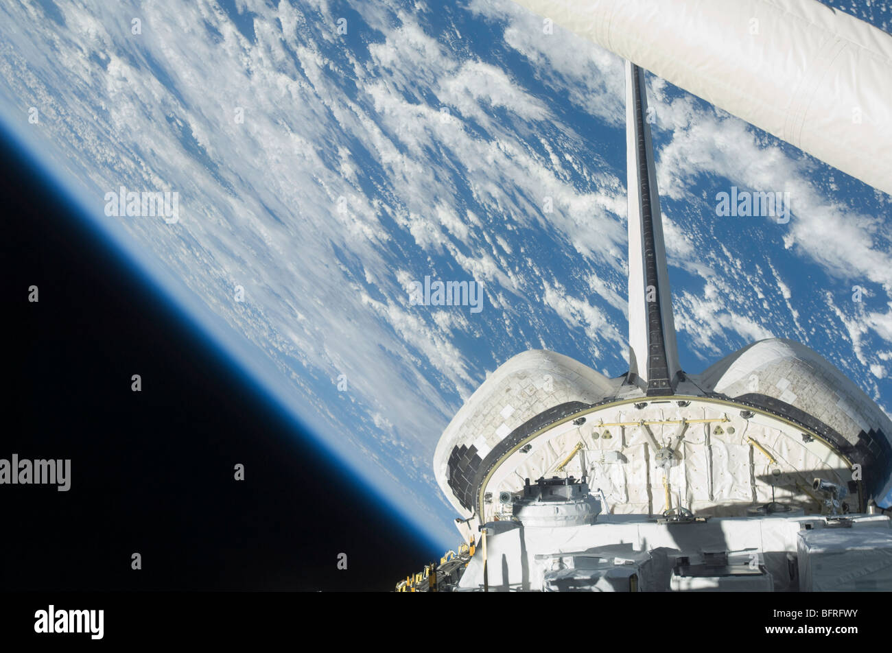 Partial view of Space Shuttle Endeavour backdropped against Earth. - Stock Image