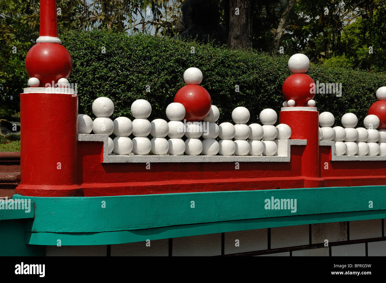 Red Boundary Wall With White Concrete Balls Tiger Balm Gardens Stock Photo Alamy