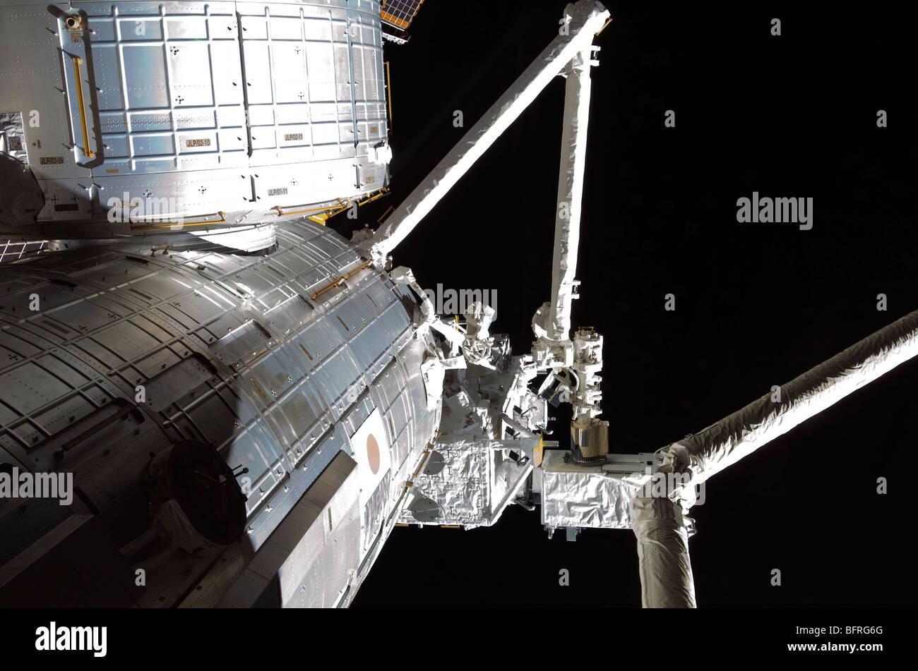 The robotic arm of the Japanese Experiment Module assists in installing components on the Japanese Exposed Facility. - Stock Image