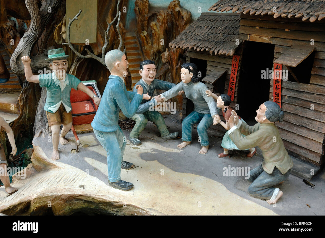 Chinese Village Debt Collector, 'Debts Lead to a Life of Ruin' Moralistic Tale, Tiger Balm Gardens Theme - Stock Image