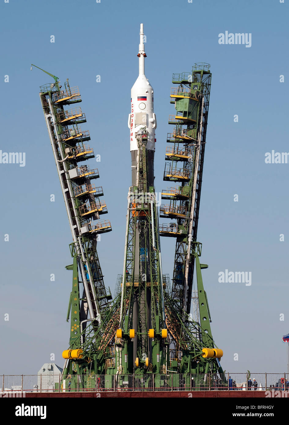 Launch scaffolding is raised into place around the Soyuz rocket. - Stock Image