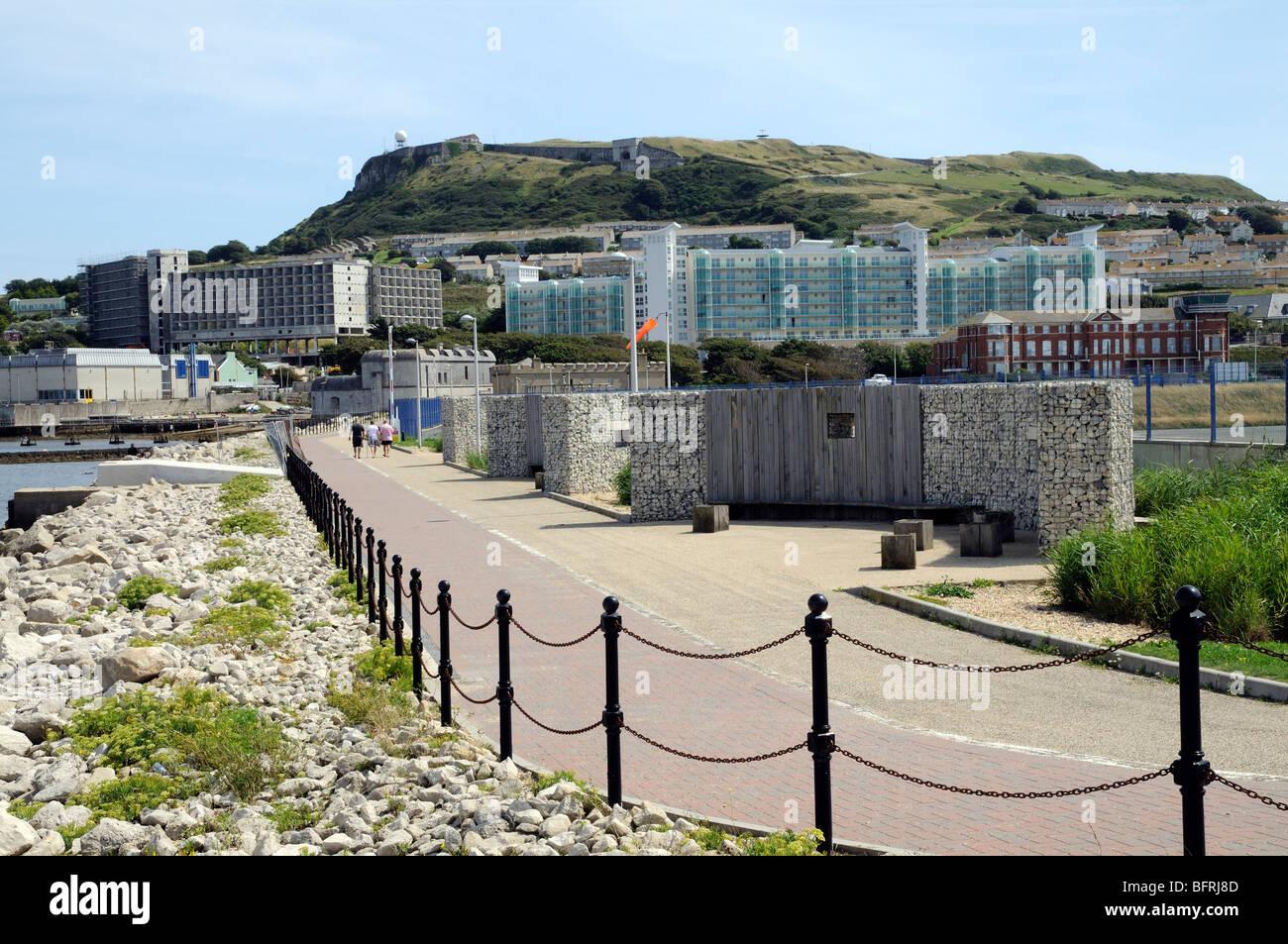 Waterfront pedestrian walkway looking towards Portland Castle Dorset southern England UK Building development - Stock Image