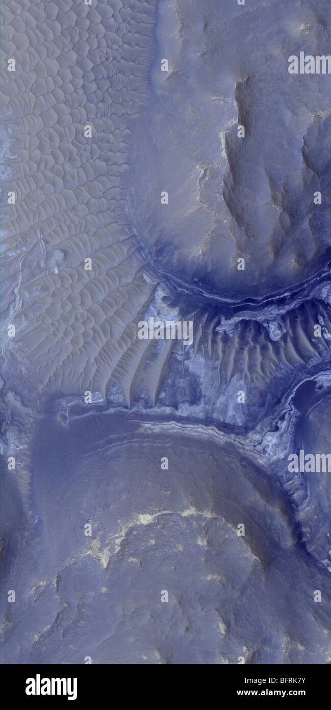 Visible in this image are layers in the lower portion of two neighboring buttes within the Noctis Labyrinthus formation - Stock Image