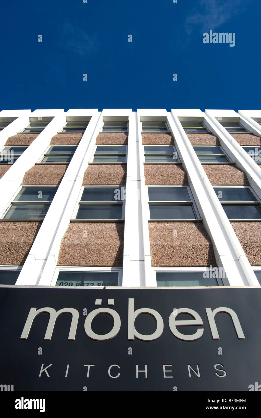 moben kitchens sign below an office block in kingston upon thames, surrey, england - Stock Image