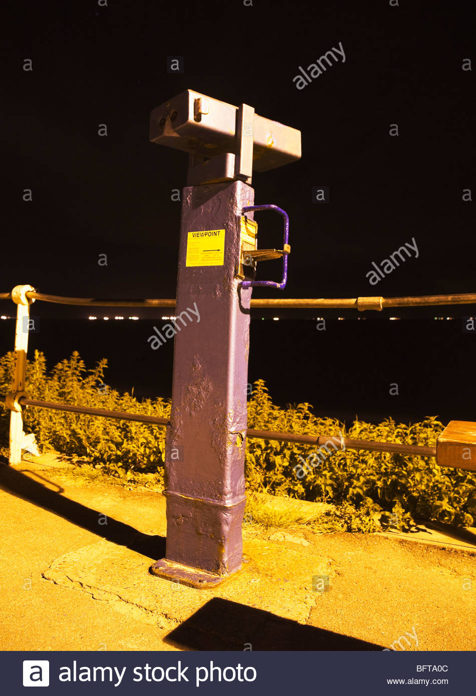Coin operated telescope at night - Stock Image
