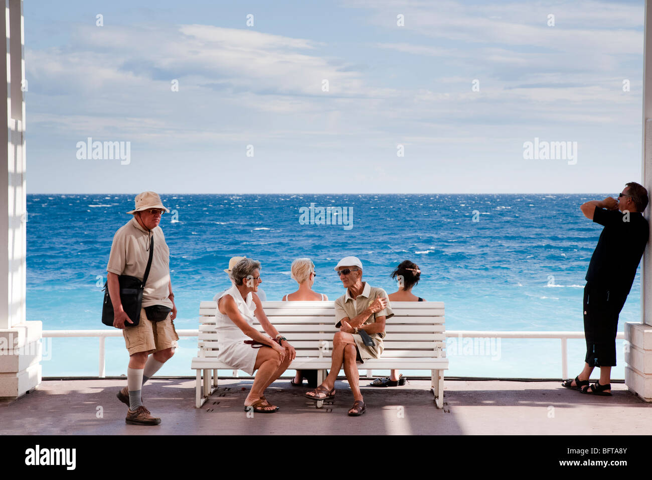 People sitting and passing time, Promenade des Anglais, Nice, Provence, France - Stock Image